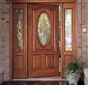 двери для коттеджа с отделкой деревом
